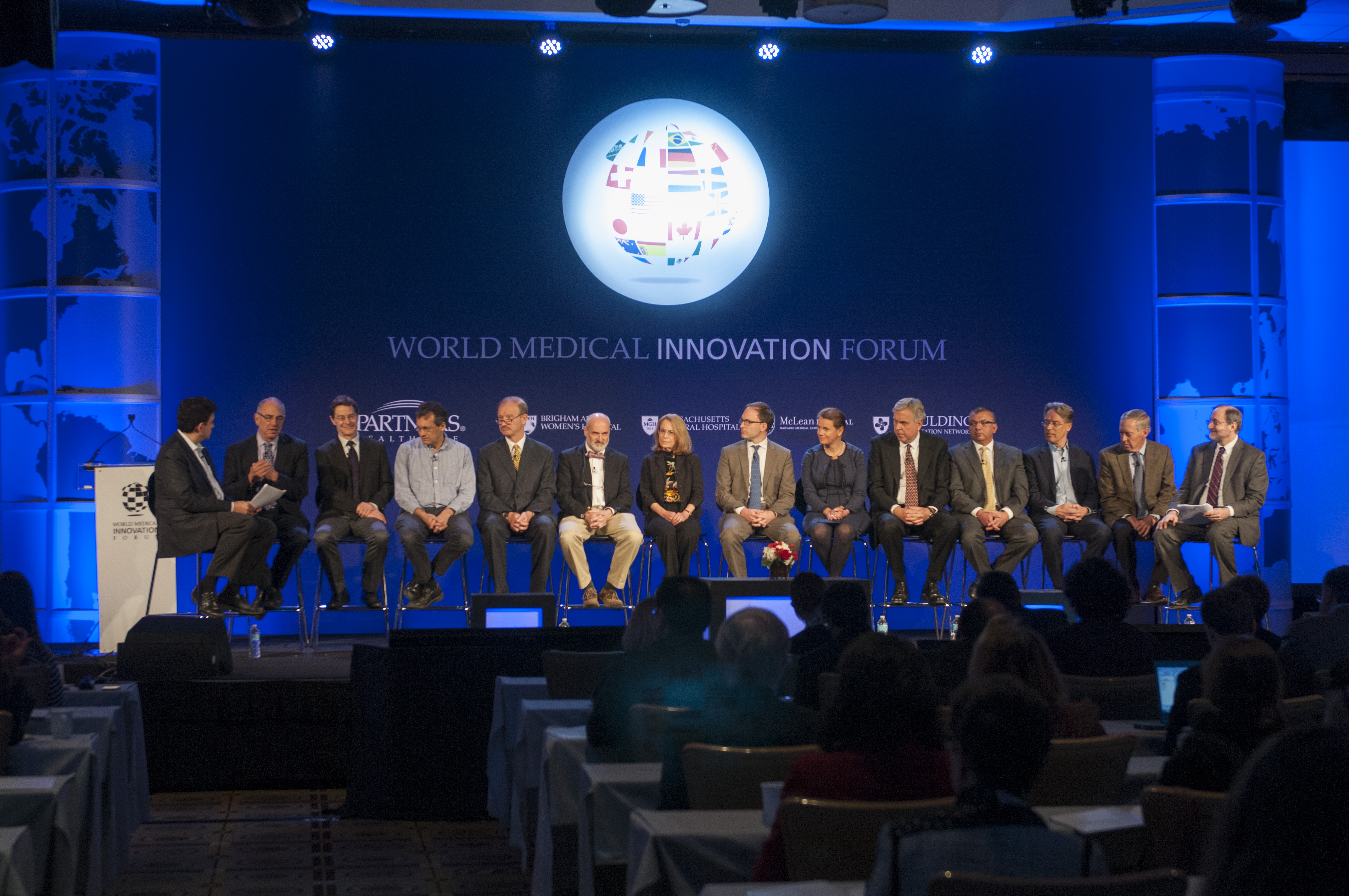 "MGH's Dr. Rudolph Tanzi, far left, and BWH's Dr. David Silbersweig, far right, join the ""Disruptive Dozen"" champions for a discussion on where innovation is headed."