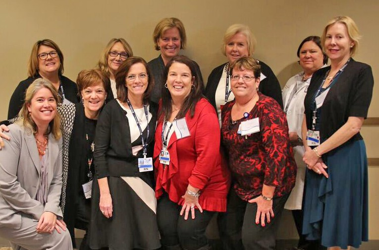 A group of meeting attendees, including BWH and BWFH CDI team members