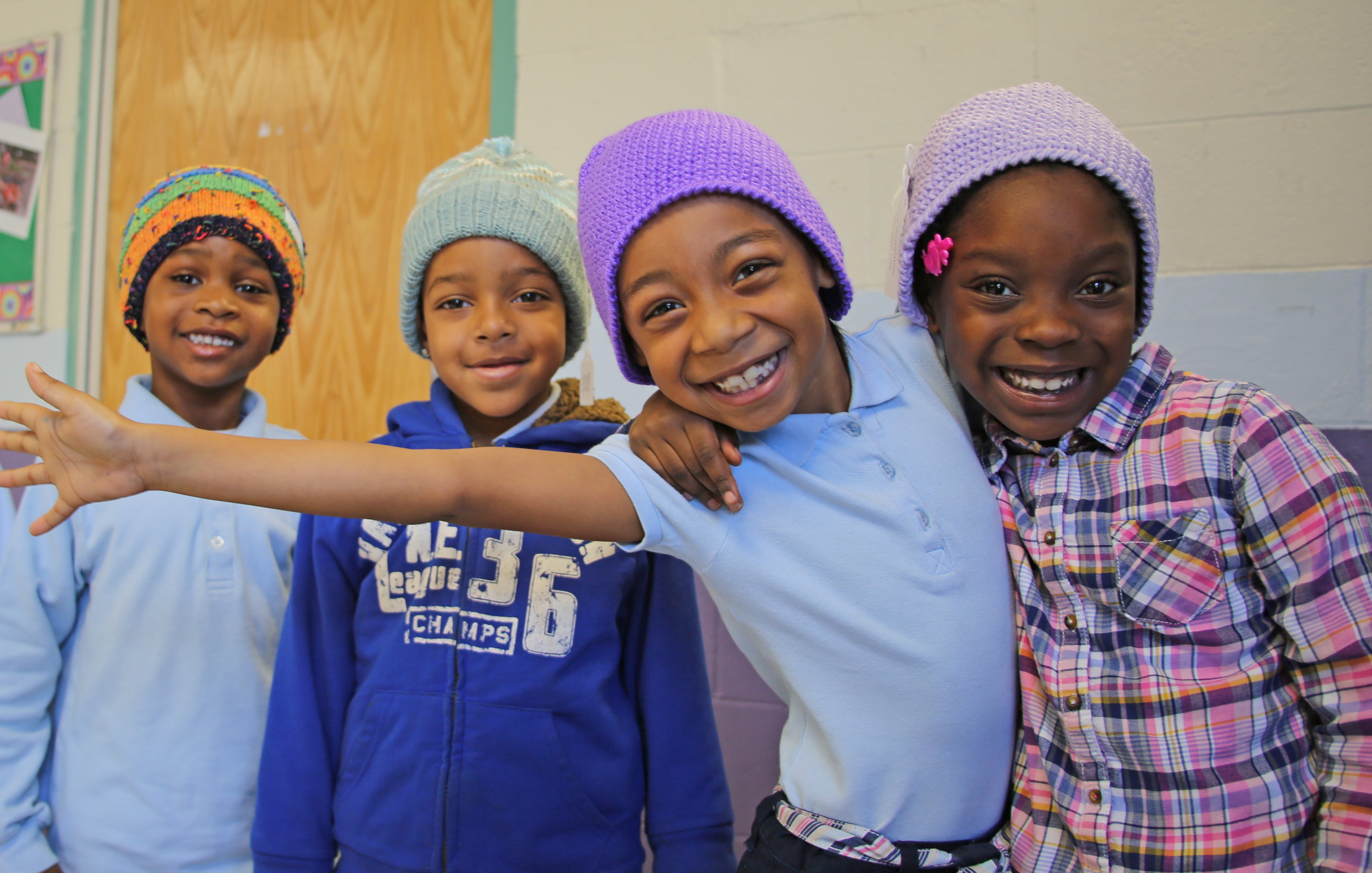 Tobin Elementary School students enjoy their new knit caps.