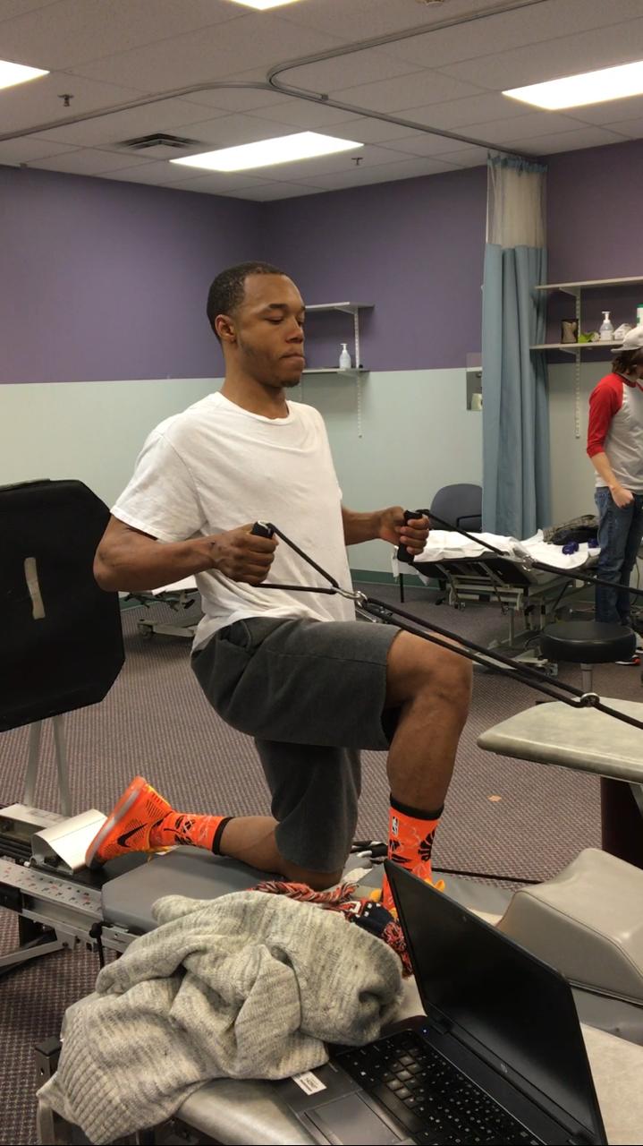 Anthony Hodges practicing rehabilitation exercises