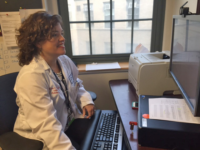 Endocrinologist and Brigham Diabetes Program Director Marie McDonnell conducts a video visit with one of her patients.