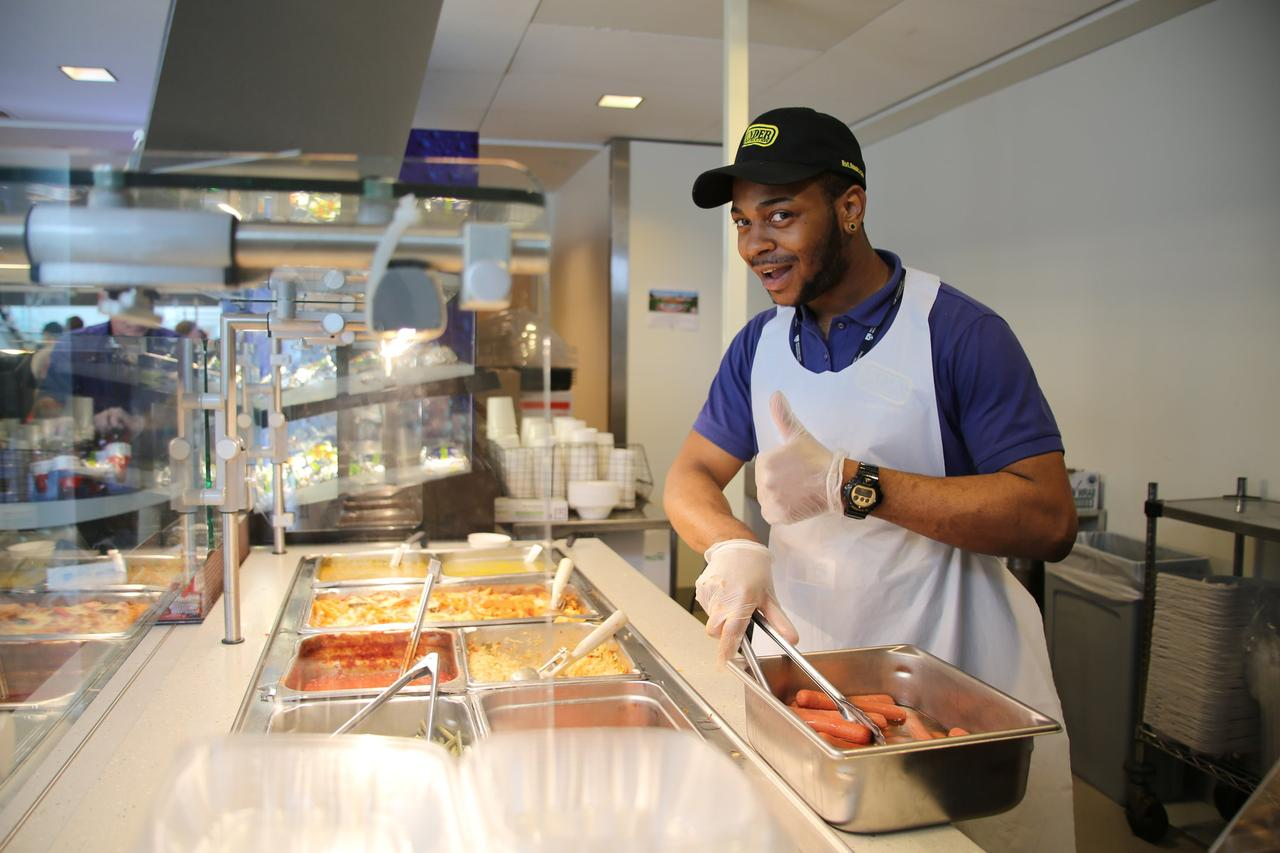 Trevon Campbell, of Food Services, served up hotdogs at the Pop-Up on the Pike.