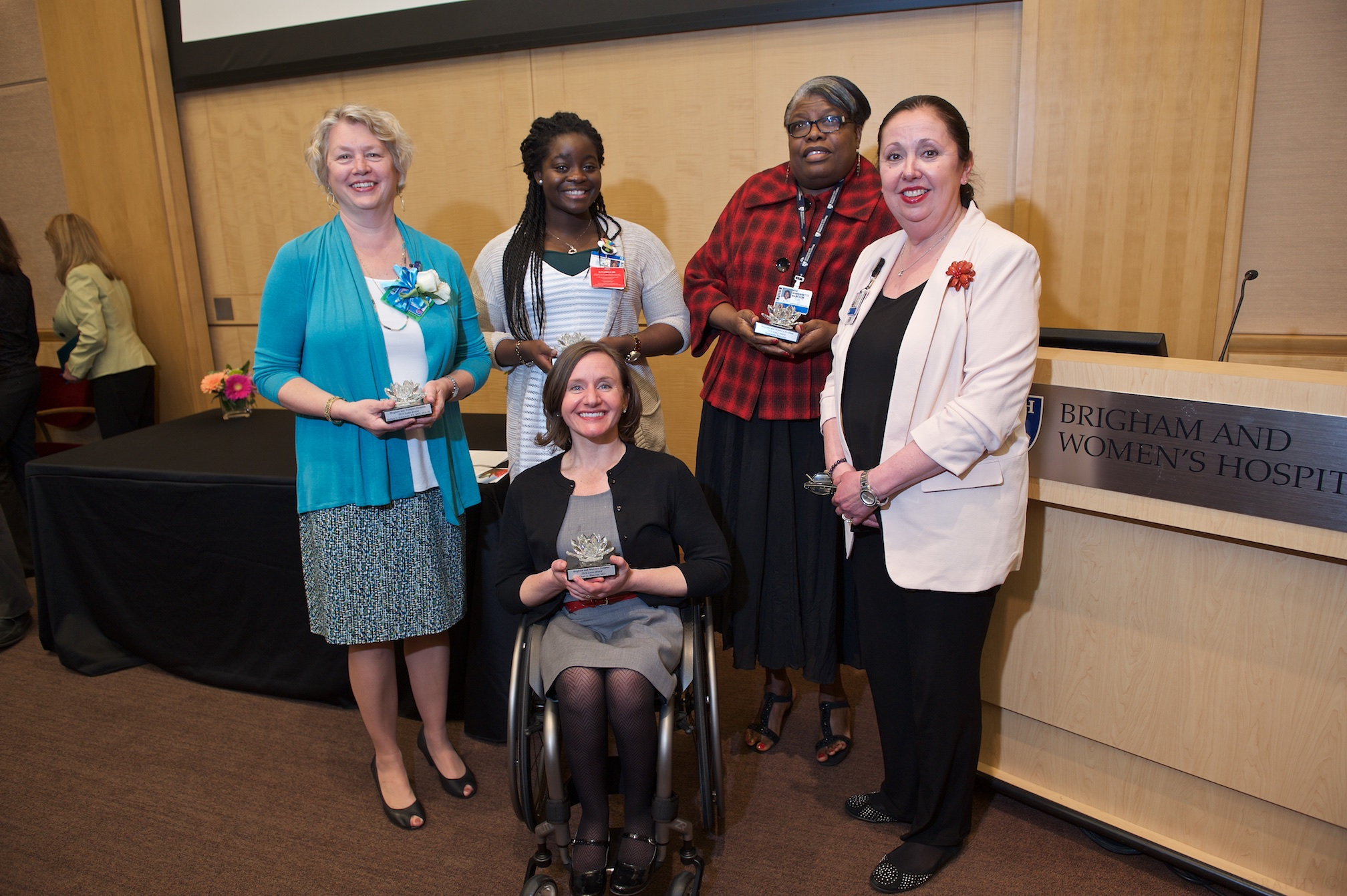 From left: Lotus Award recipients Barbara Kalinowski, Maxine Rose, Cheri Blauwet and Margarette Marcelin, with Jackie Somerville