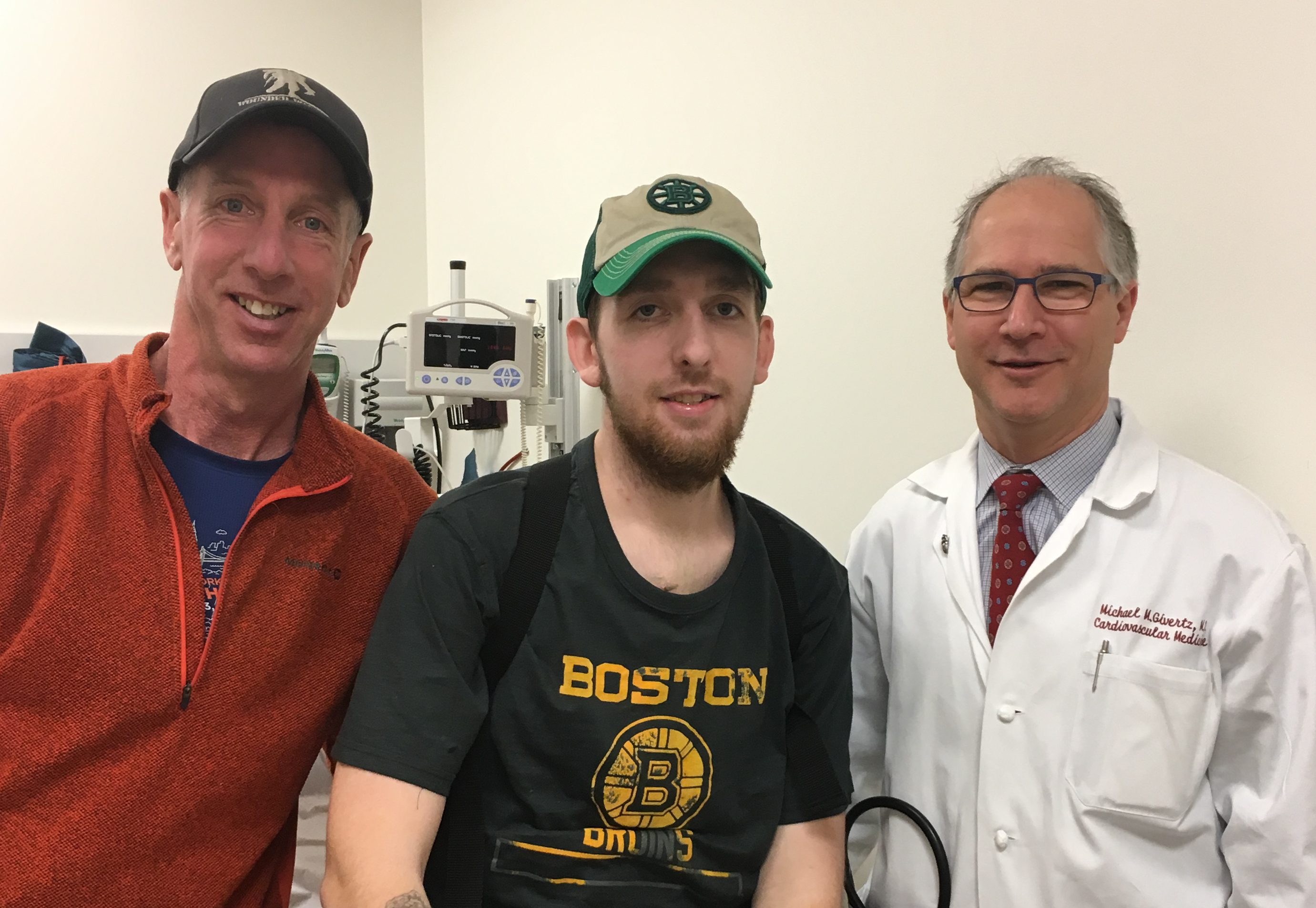 Conor Sullivan (center), with his father, Michael, and cardiologist Michael Givertz