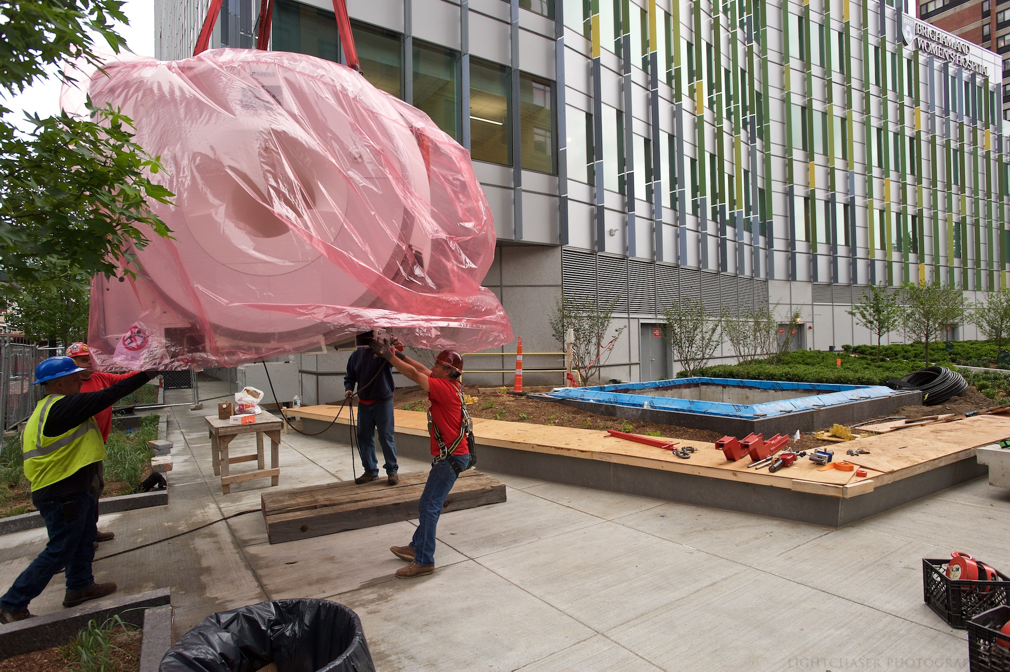 A 3.0 Tesla MRI scanner is hoisted toward the access shaft leading to the lower levels of the BBF.