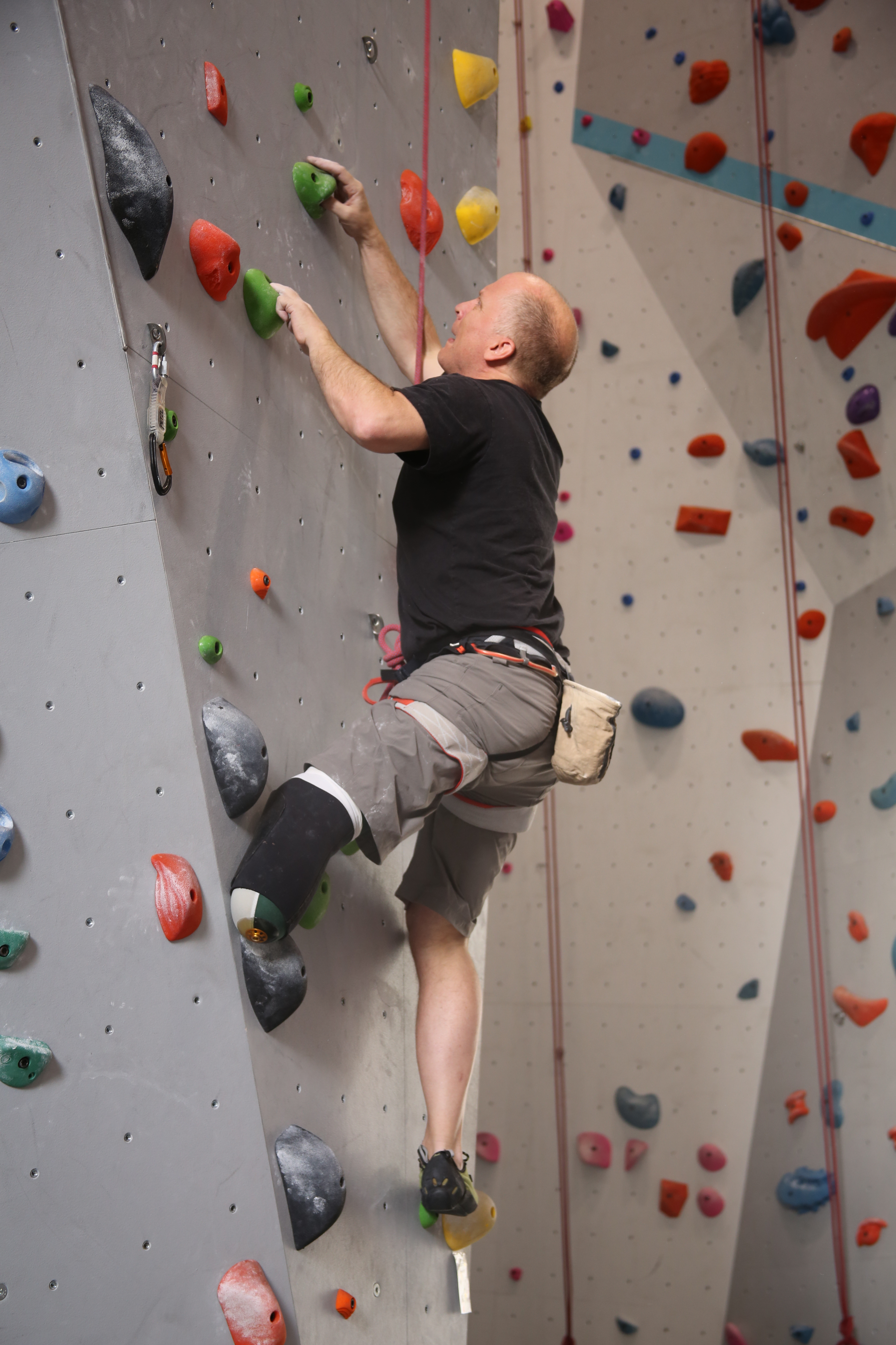 Jim Ewing scales an indoor climbing wall after his amputation.