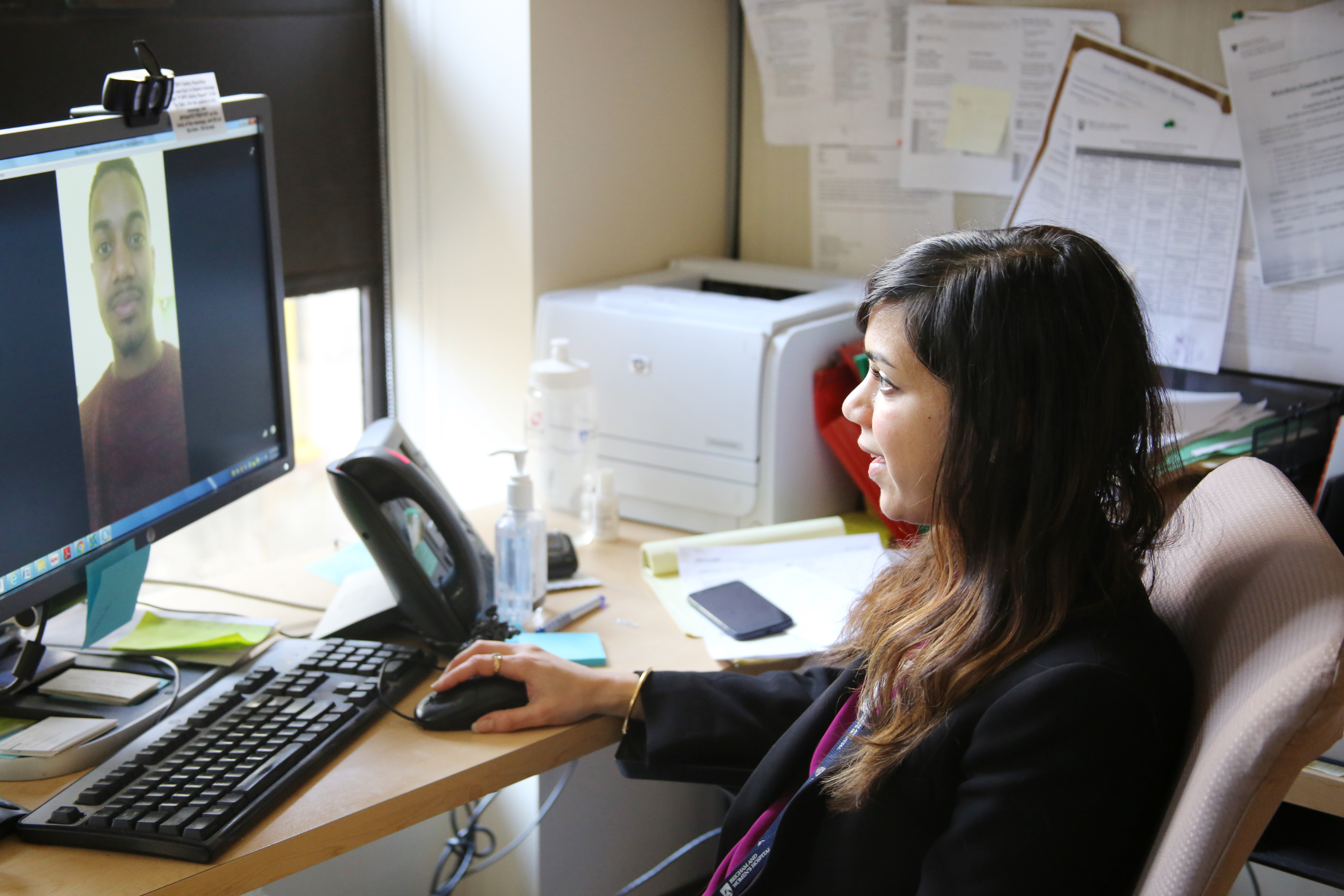 Ash Nadkarni demonstrates a virtual visit in her office at 850 Boylston St.