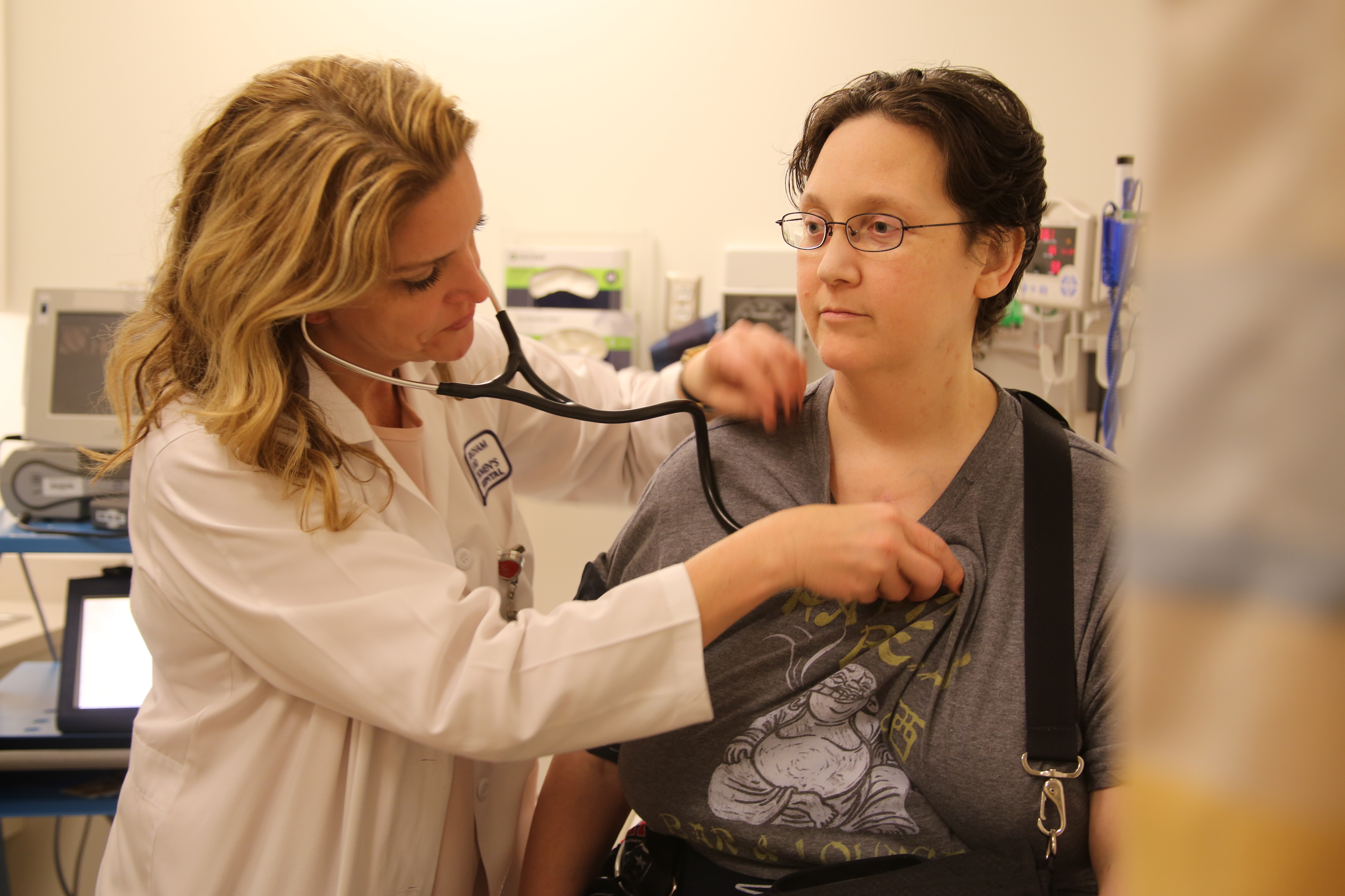 From left: Nurse practitioner Lara Coakley listens to patient Amy Prince's heart during a recent appointment.