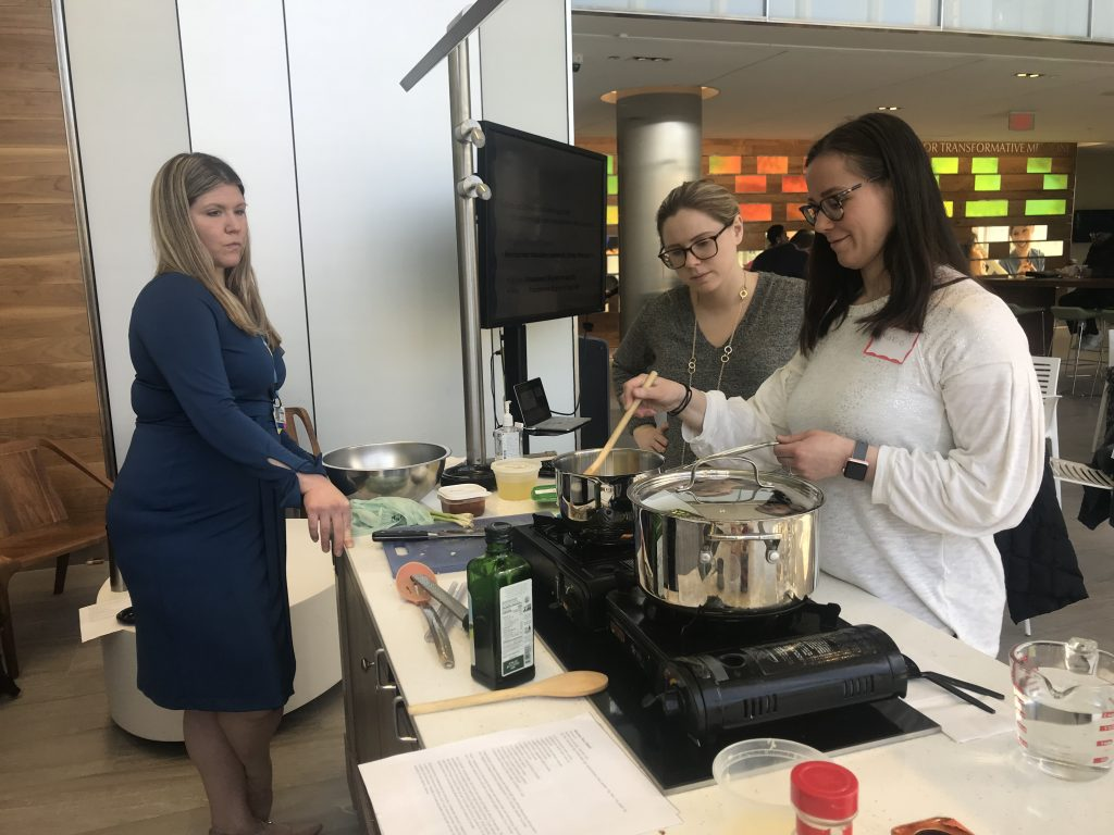 From left: Kelley Bradshaw observes participants Johanna Younghans and Marie Koch during a recent cooking and nutrition class.