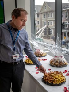 Damon Wallace of Materials Management samples some Persian sweets.