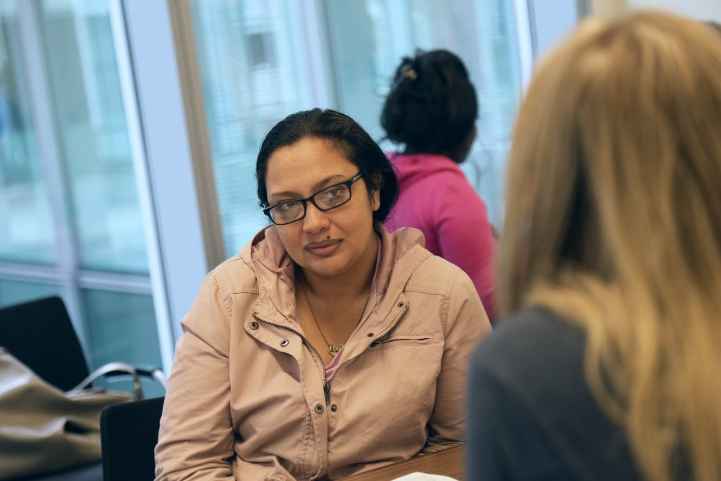 Wendy Figueroa meets with a volunteer during the Career Day event