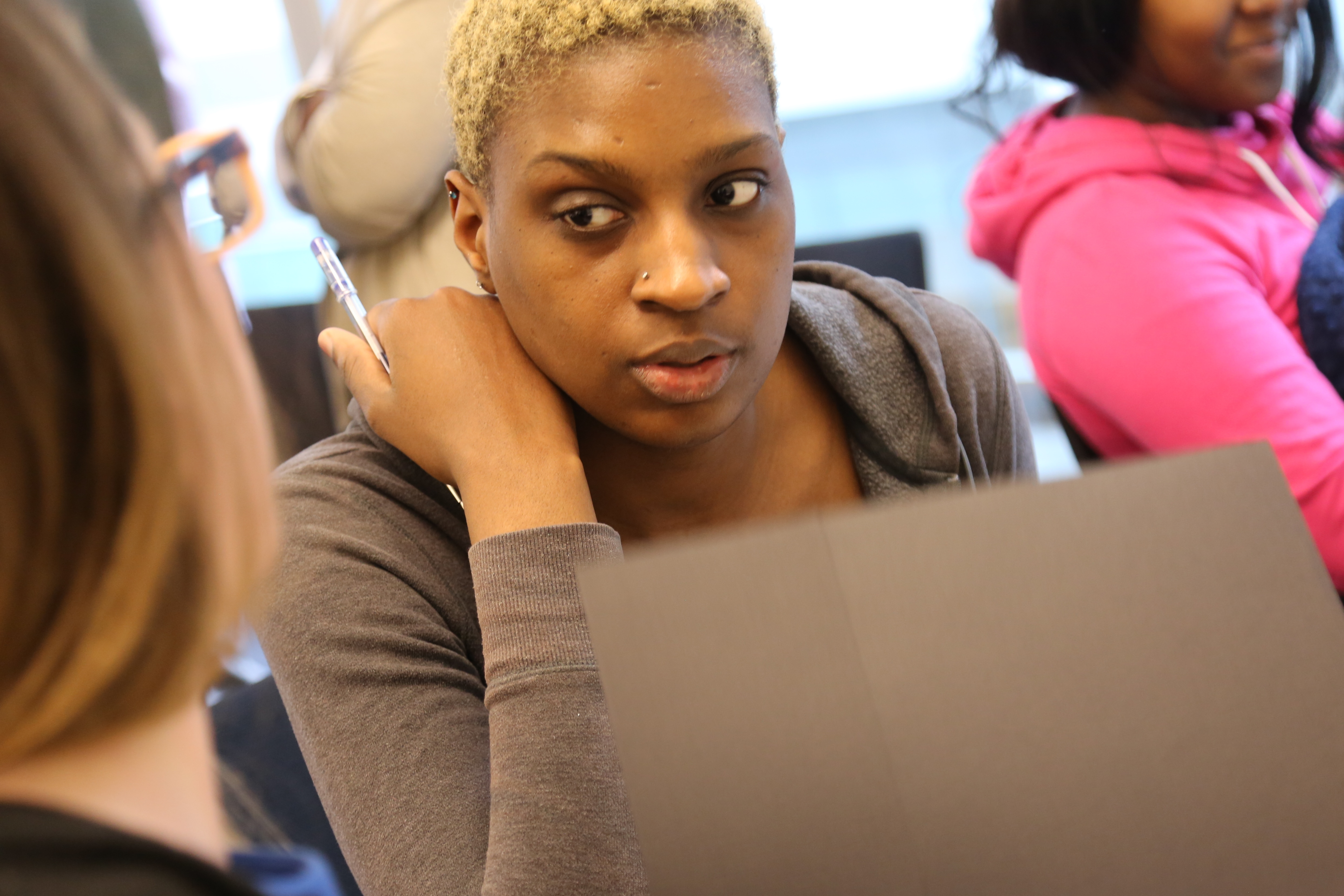 Jasmine Sealy-Norvin receives tips on resumé writing from a volunteer during Bridges to Moms' recent Career Day event.