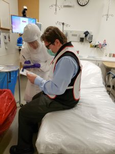 Deborah Gayoski collects information from Mark Litvak, role-playing as a patient with suspected Ebola.