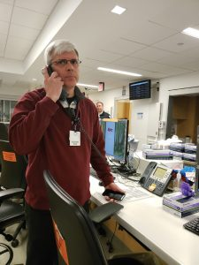 Steven Palmer responds to a call in the Emergency Department as part of the exercise.