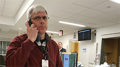 Steven Palmer responds to a call in the Emergency Department as part of the exercise