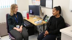 From left: Kate Gasparrini listens to Melinda, a patient at Brookside Community Health Center, during a recent visit.