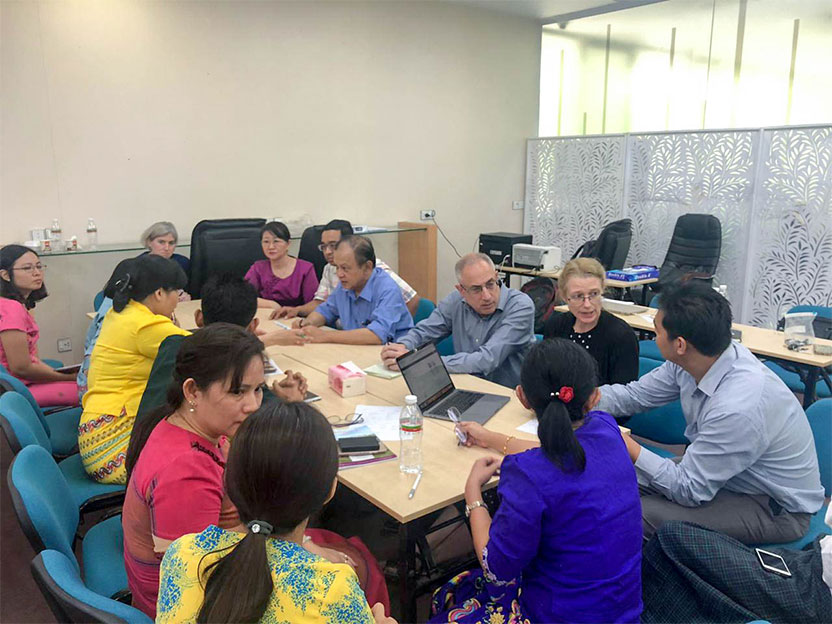 Foreground, at right: Gary Levine and Jane Brock meet with pathologists in Myanmar.
