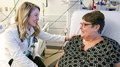 From left: Erin Lyons Matiello visits Kerry Bergeron after a recent Easter celebration for VAD patients.