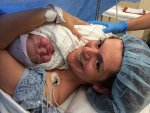 Vesela Kovacheva snuggles with her oldest daughter, Kalina, moments after her birth at the Brigham.