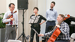 Residents Jack Qian, MD, of the Department of Radiation Oncology, Priscilla Wang, MD, of the Department of Medicine, Mike Foote, MD, of Department of Medicine, and Fritz Stabenau, MD, PhD, of the Department of Medicine, perform Piano Trio No. 2 in C major, second movement, by Johannes Brahms.
