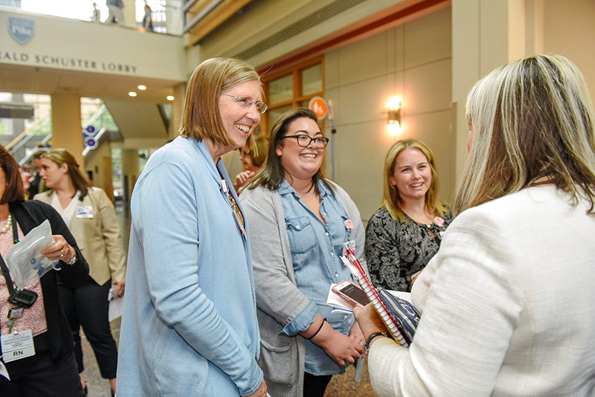 From left: Sarah Thompson, Catherine Masse and Maureen Tapper discuss their research during a poster presentation.