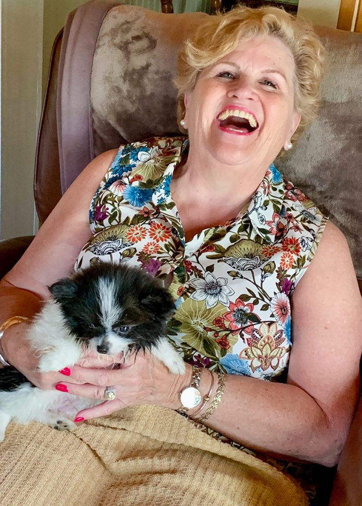 Sabina Barry, cardiac patient, cuddles with her recently adopted puppy, Poco.