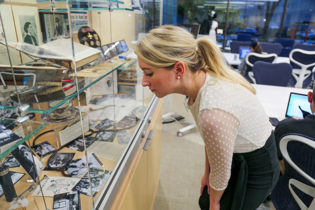 woman looking into exhibit display glass