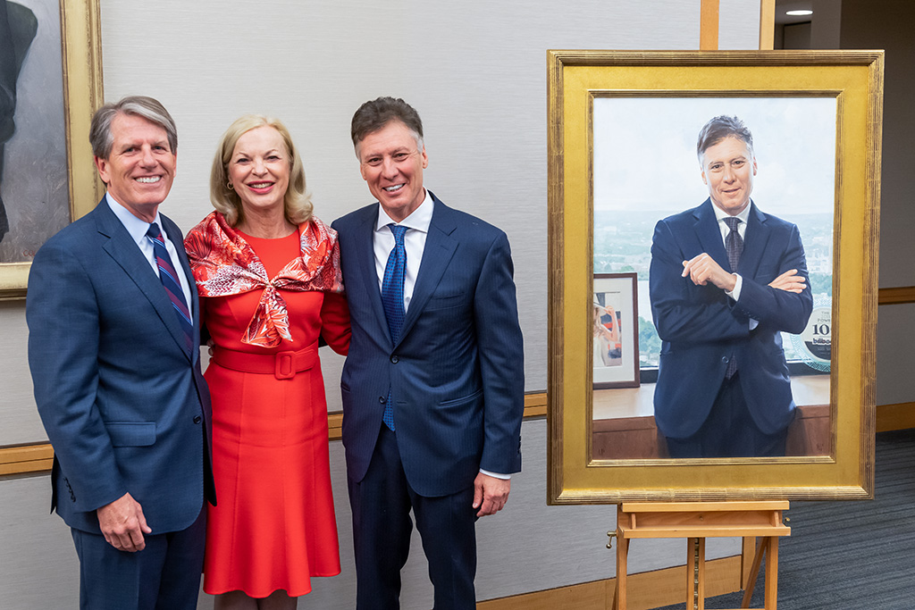 Ron Walls, Betsy Nabel, and Scott Sperling standing next to portrait of Sperling