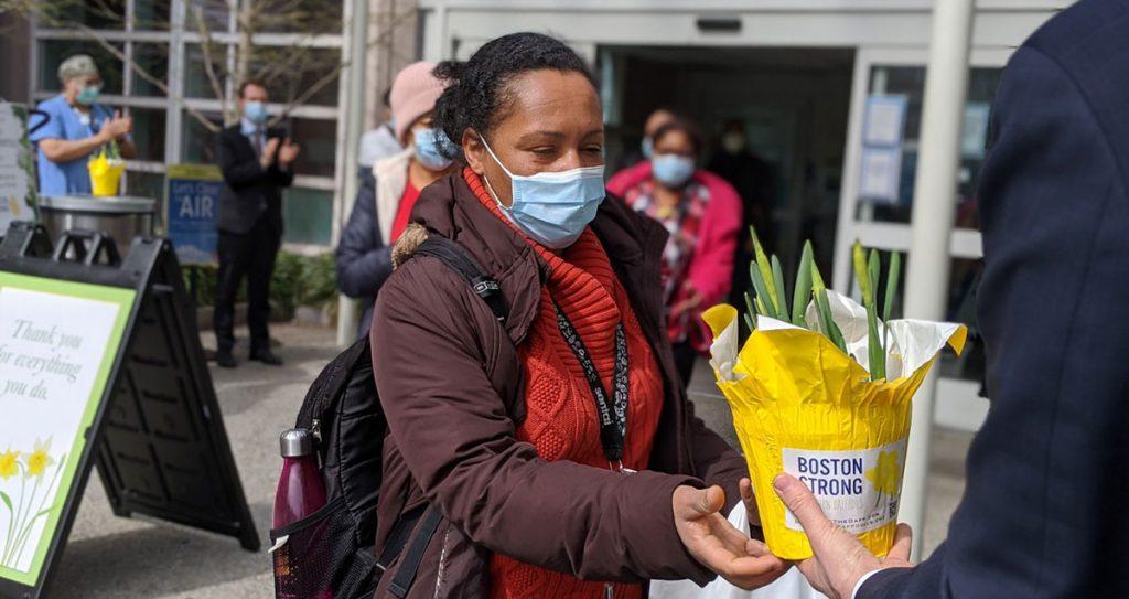 Woman receiving flower plant