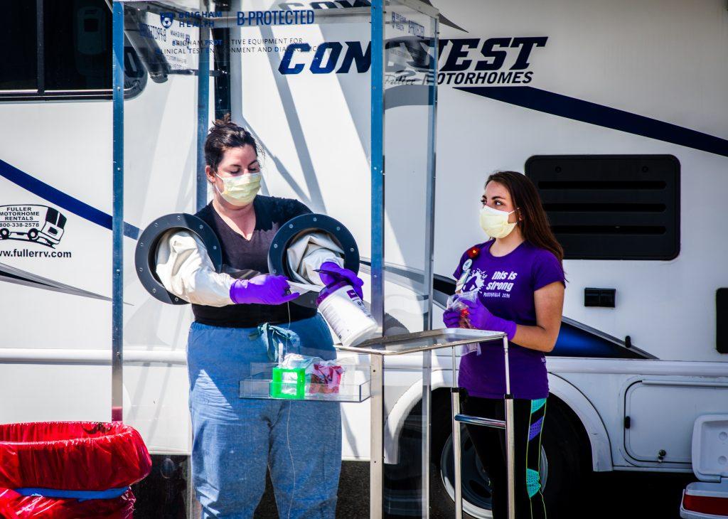 Victoria Addonizio and Krista Atherton prepare a COVID-19 testing booth
