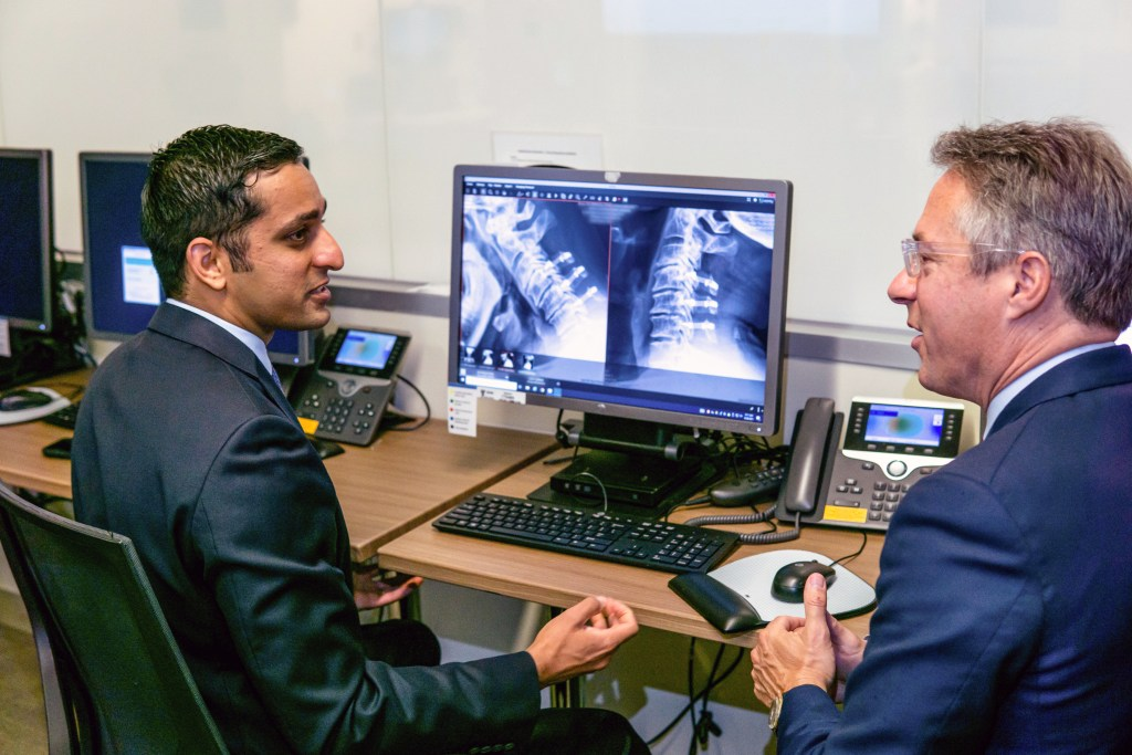 Two doctors discuss X-ray results
