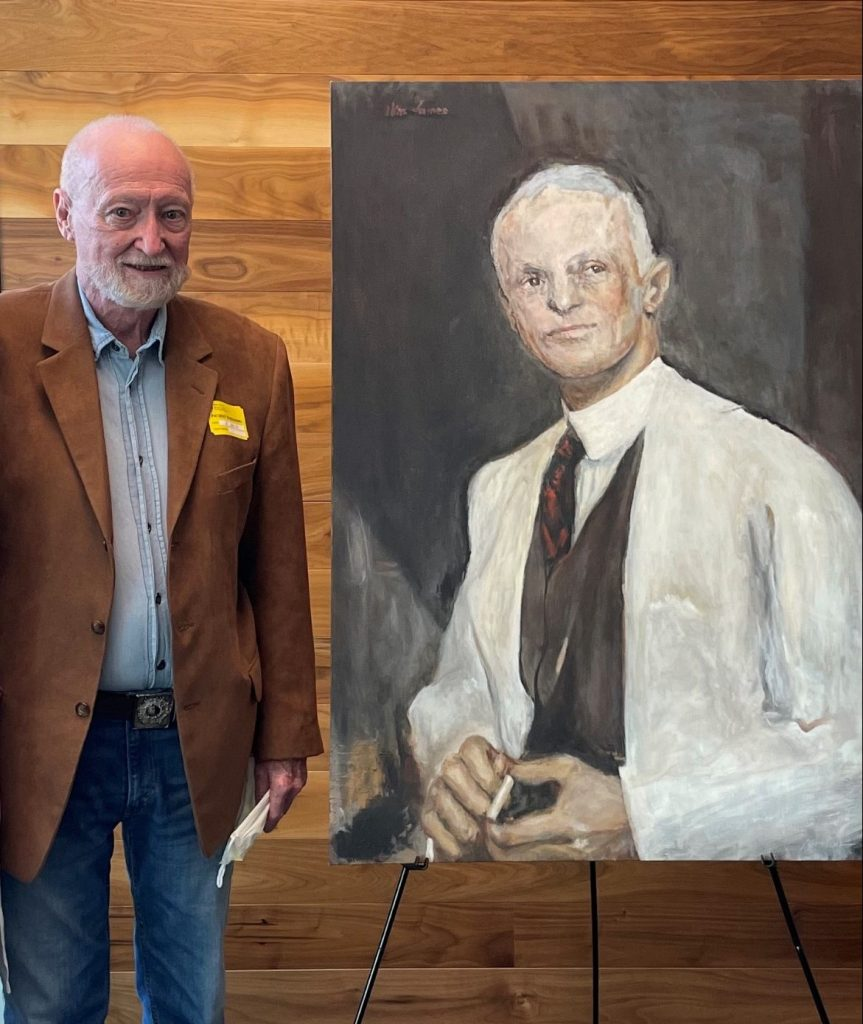 Man standing next to painting